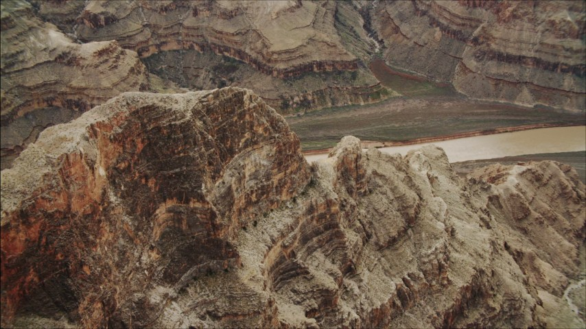 4K stock footage aerial video of flying over a rock formation near the Colorado River in Grand Canyon, Arizona Aerial Stock Footage | DCA04_043