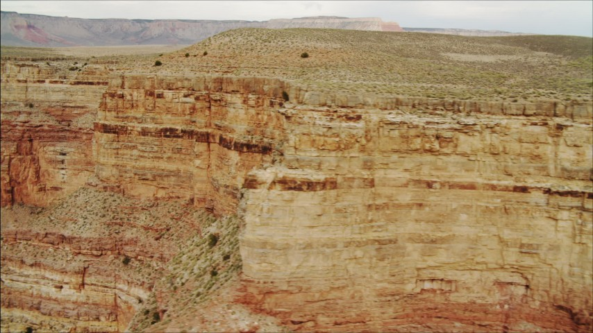 4K stock footage aerial video of flying by a cliff face in Grand Canyon, Arizona Aerial Stock Footage | DCA04_046