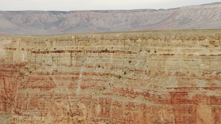 4K stock footage aerial video of panning across summit of a cliff in Grand Canyon, Arizoa Aerial Stock Footage | DCA04_047
