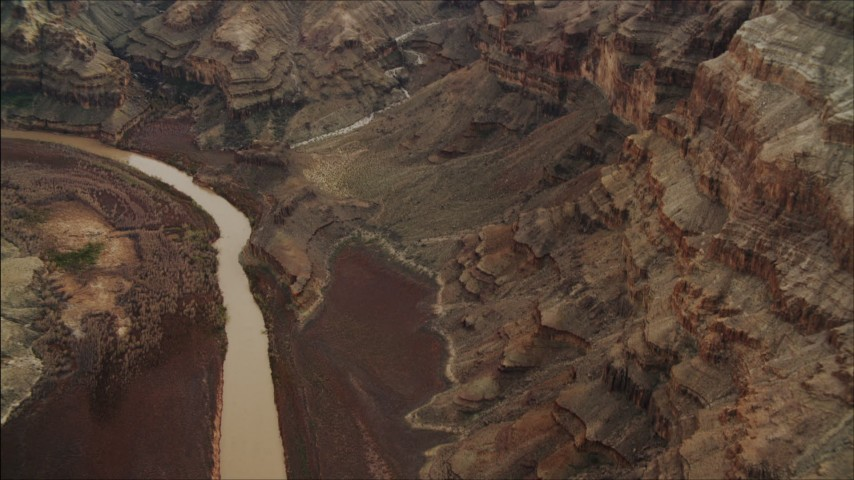 4K stock footage aerial video of panning across the Colorado River, and tilt to rock formations in Grand Canyon, Arizona Aerial Stock Footage | DCA04_052