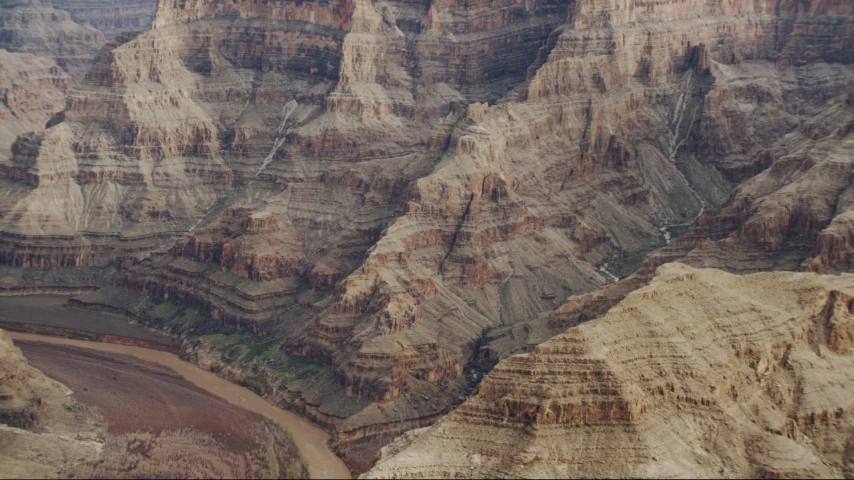 4K stock footage aerial video of rock formations near Colorado River in Grand Canyon, Arizona Aerial Stock Footage | DCA04_055