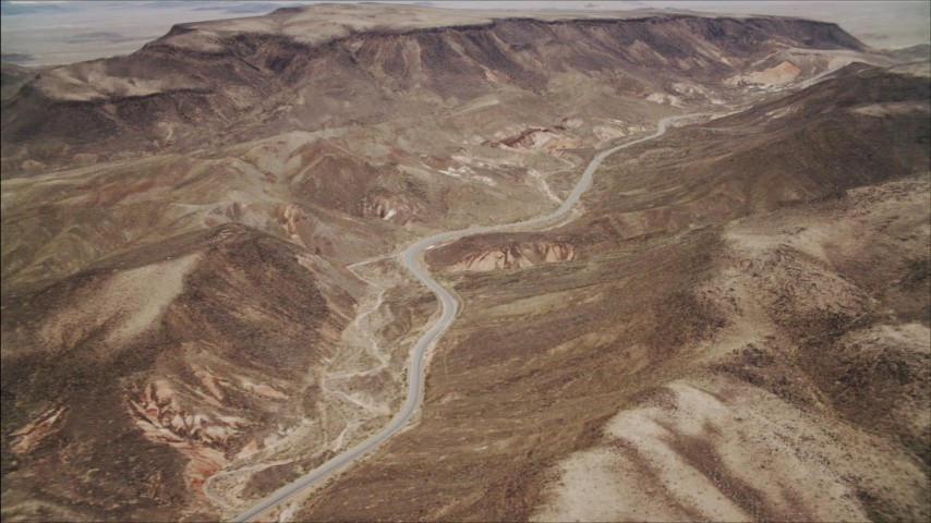 4K stock footage aerial video of following a winding road in the Nevada Desert, Nevada Aerial Stock Footage | DCA04_095