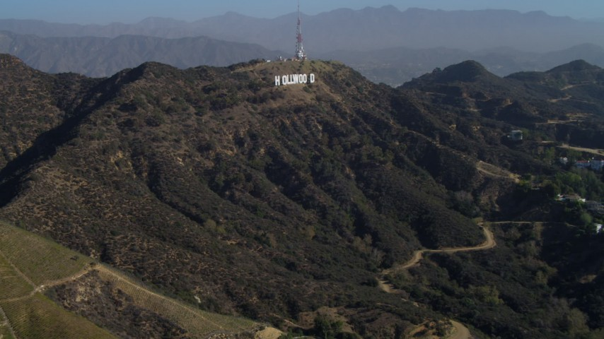 4K stock footage aerial video of flying over Hollywood Hills, approaching Hollywood Sign, Los Angeles, California Aerial Stock Footage | DCA05_005