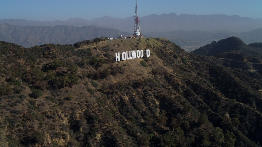 4K stock footage aerial video of approaching the Hollywood Sign, Los Angeles, California Aerial Stock Footage | DCA05_006