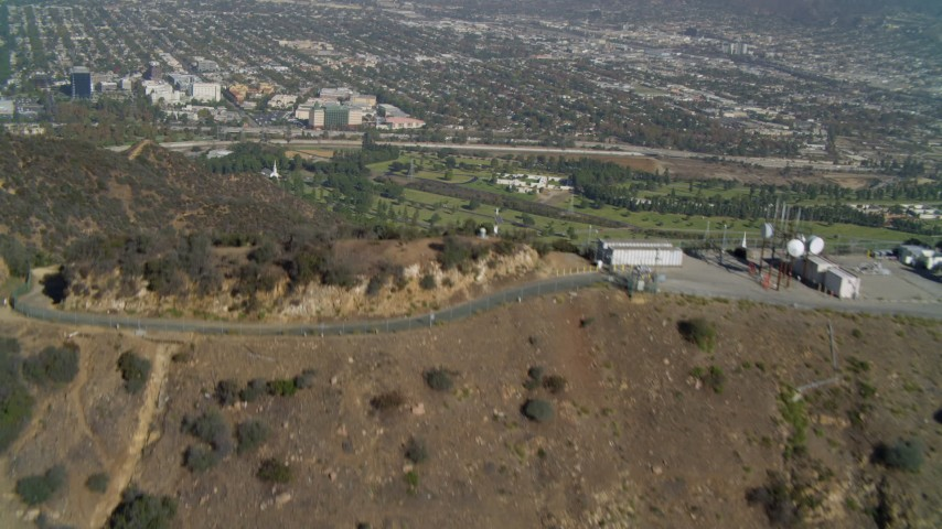 4K stock footage aerial video of Hollywood Hills, Hollywood Sign, Forest Lawn Memorial Park, Los Angeles, California Aerial Stock Footage | DCA05_009