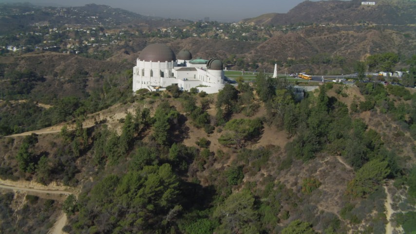 4K stock footage aerial video tilt up hill, revealing Griffith Observatory, Los Angeles, California Aerial Stock Footage | DCA05_016