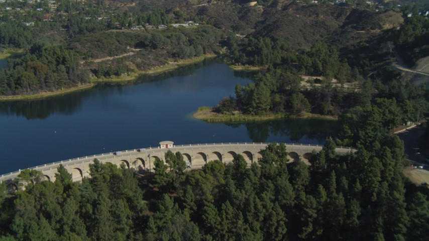 4K stock footage aerial video of flying over Mulholland Dam, Hollywood Reservoir, Los Angeles, California Aerial Stock Footage   DCA05_020
