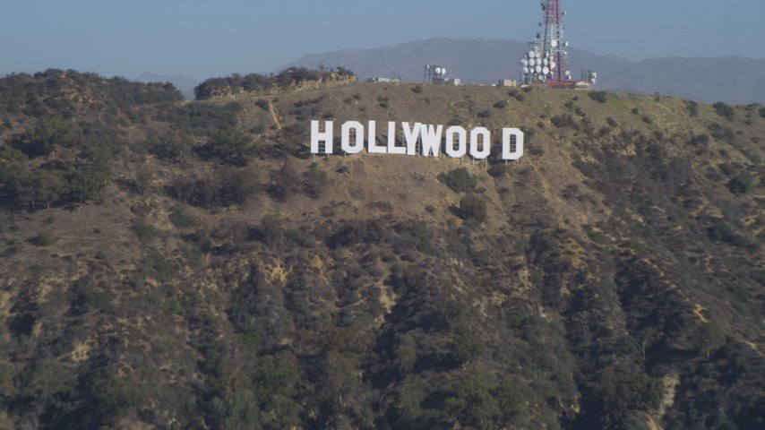 4K stock footage aerial video tilt from the Hollywood Reservoir, revealing Hollywood Sign, Los Angeles, California Aerial Stock Footage | DCA05_021
