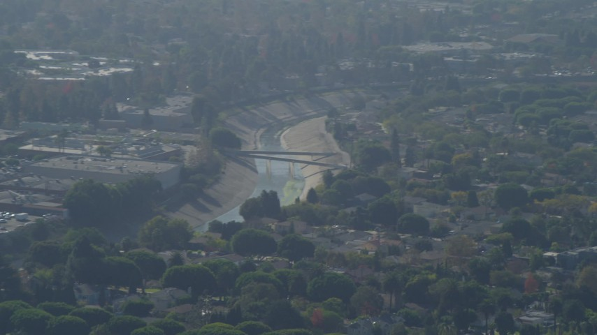 4K stock footage aerial video of approaching Ballona Creek, Baldwin Hills, zoom in, Culver City, California Aerial Stock Footage | DCA05_060