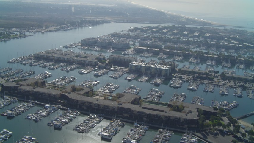 4K stock footage aerial video of flying over the marina, tilt down on boats, Marina Del Rey, California Aerial Stock Footage | DCA05_064