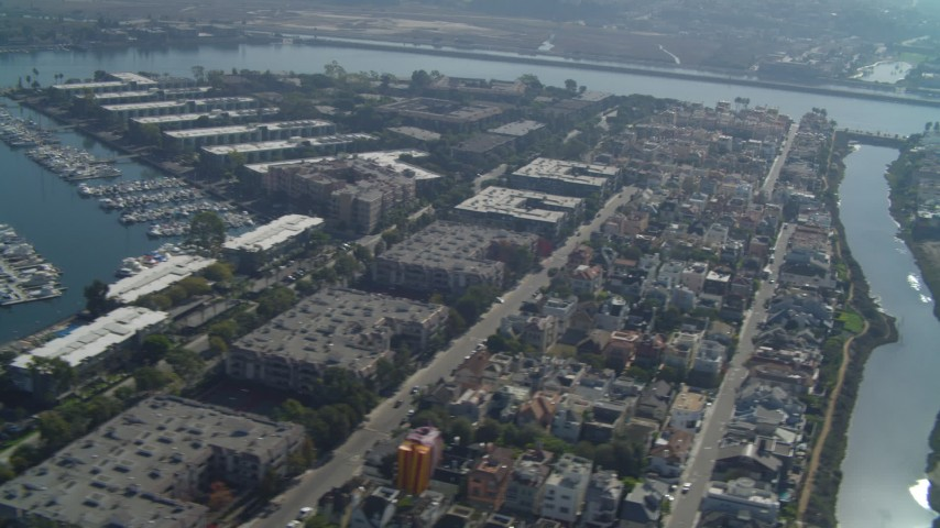 4K stock footage aerial video of flying by boats in the marina, residential neighborhoods, Marina Del Rey, California Aerial Stock Footage | DCA05_066