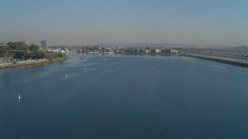4K stock footage aerial video of flying by the mouth of the marina and homes, Marina Del Rey, California Aerial Stock Footage | DCA05_067