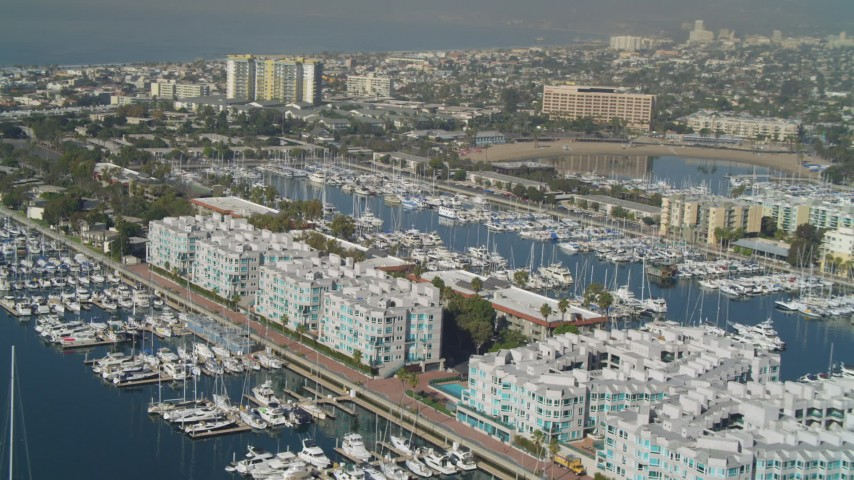 4K stock footage aerial video of boats in the marina and waterfront apartment buildings, Marina Del Rey, California Aerial Stock Footage | DCA05_070