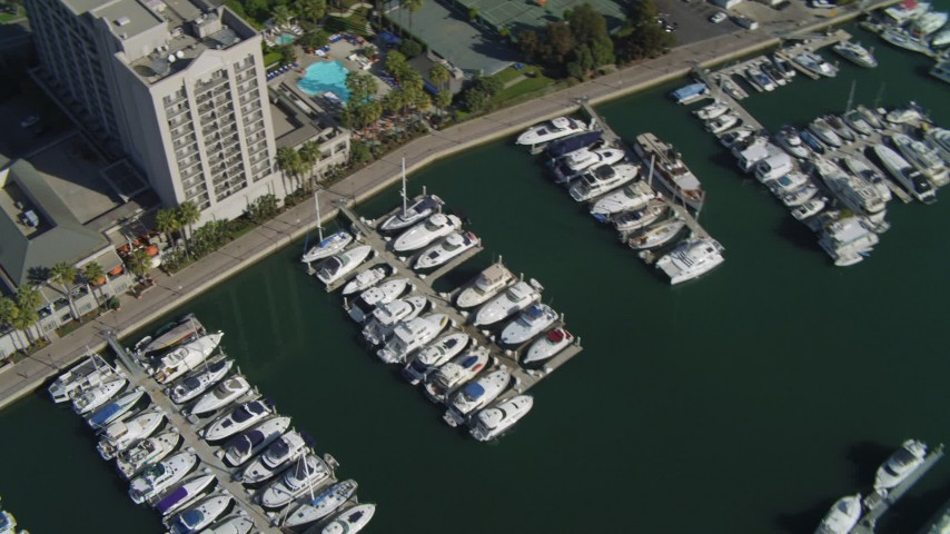 4K stock footage aerial video pan across boat in the marina; Marina Del Rey, California  Aerial Stock Footage | DCA05_072