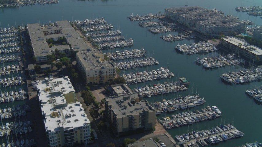 4K stock footage aerial video of flying over apartment complexes and docked boats, Marina Del Rey, California Aerial Stock Footage | DCA05_073