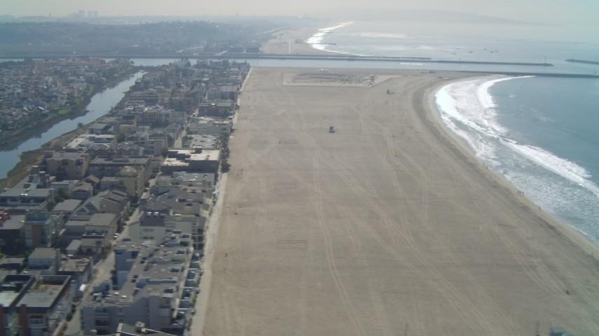 4K stock footage aerial video of flying by Ballona Lagoon, homes and coastal beach; Marina Del Rey, California Aerial Stock Footage | DCA05_074