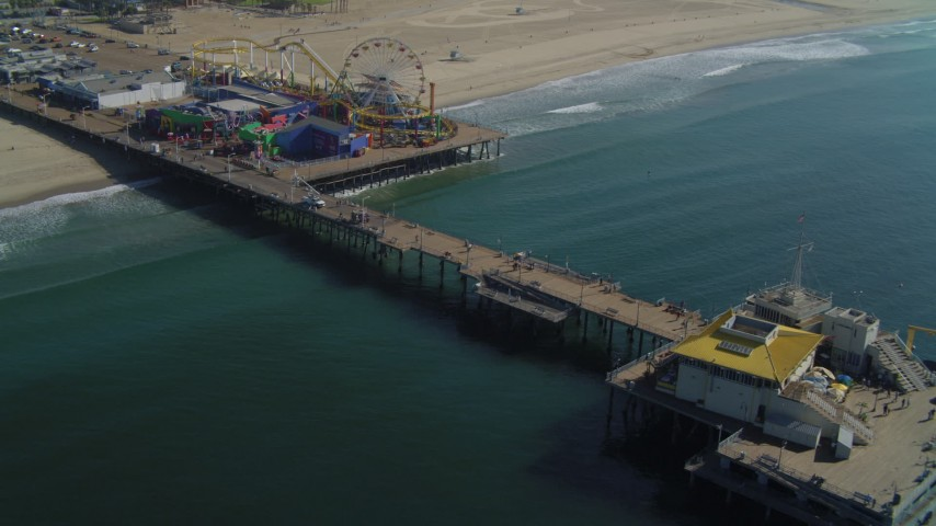 Fly by Santa Monica Pier, ascend and pan back to pier, Santa Monica, California Aerial Stock Footage | DCA05_080