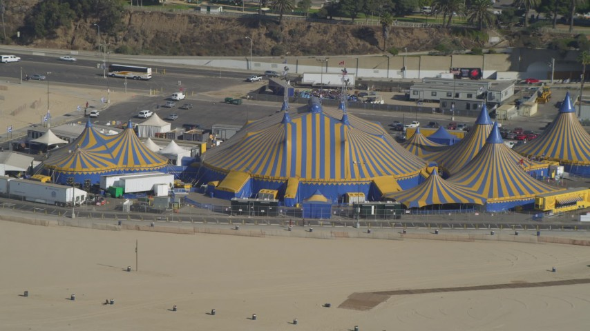 4K aerial video approach Santa Monica Pier, circus tents on beach, Santa Monica, California Aerial Stock Footage | DCA05_081