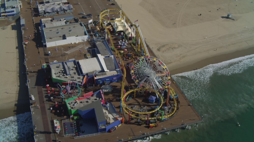 4K aerial video tilt to bird's eye view of Santa Monica Pier rides, Santa Monica, California Aerial Stock Footage | DCA05_082