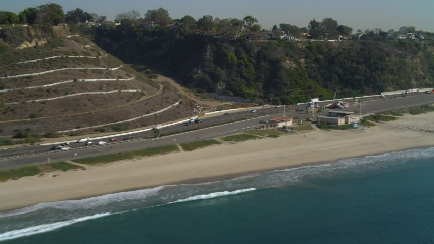 4K stock footage aerial video of flying by Highway 1, coast, Santa Monica State Beach, Santa Monica, California Aerial Stock Footage | DCA05_096