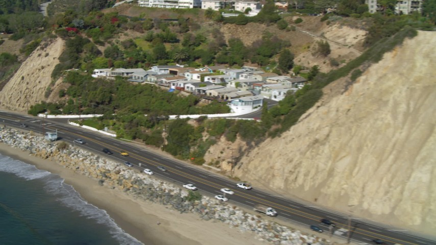 4K aerial video tilt to Highway 1, along the coast, Pacific Palisades, California Aerial Stock Footage | DCA05_098