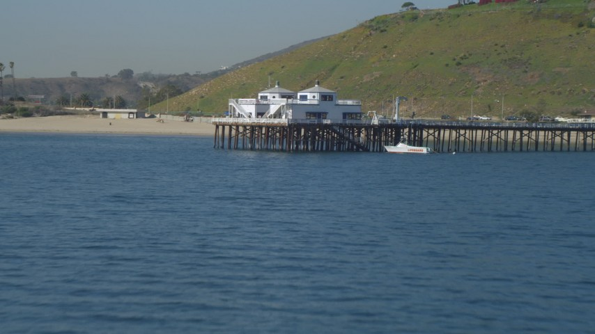 Flying over Malibu Pier, ascend to a bird's eye view, Malibu, California Aerial Stock Footage | DCA05_120