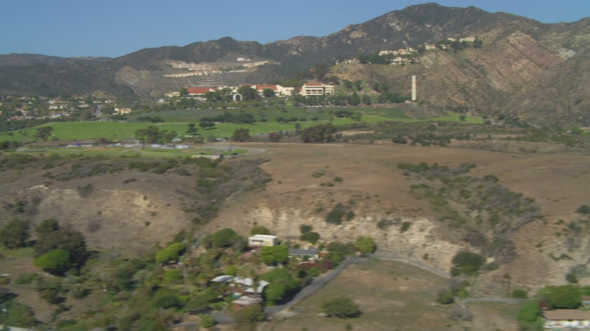 Neighborhoods in hills, Pepperdine University, coastal homes, Malibu, California Aerial Stock Footage | DCA05_122