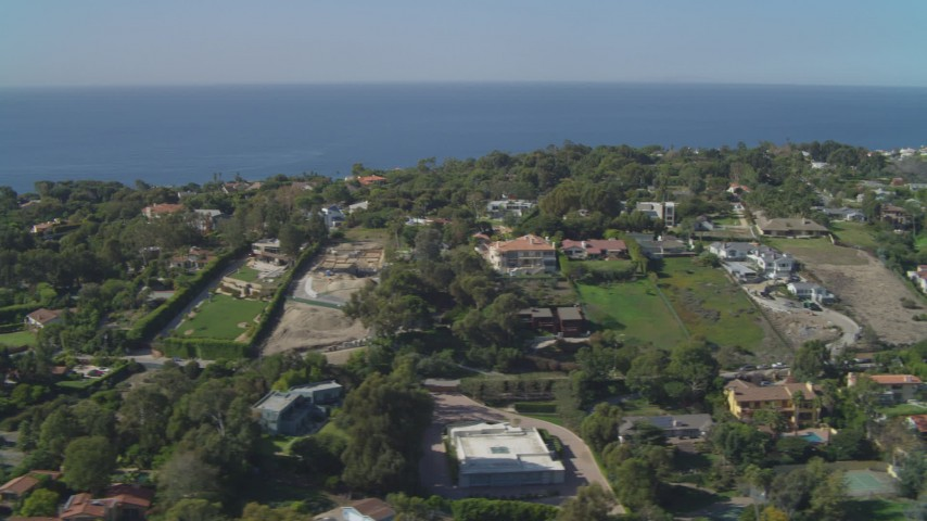 4K stock footage aerial video of flying by upscale residential neighborhoods, view of Pacific Ocean, Malibu, California Aerial Stock Footage | DCA05_131