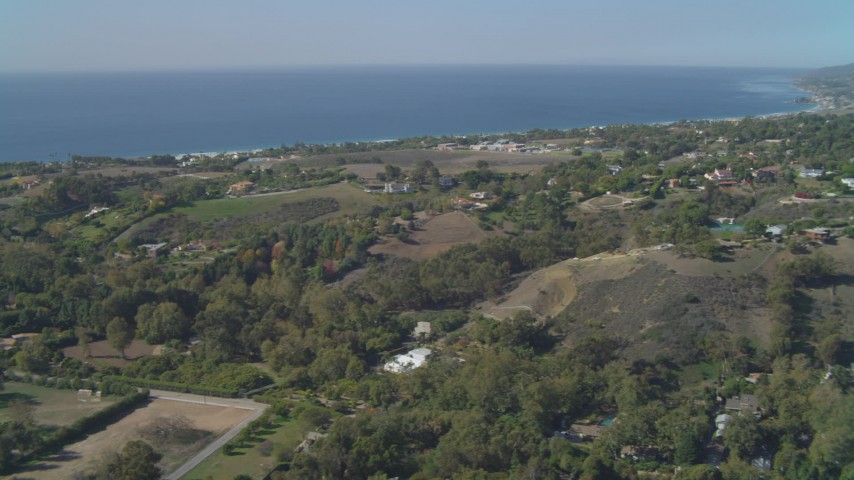 4K stock footage aerial video of flying by residential neighborhoods, view of the ocean, Malibu, California Aerial Stock Footage | DCA05_132