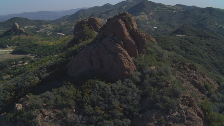 4K stock footage aerial video of orbiting a hilltop rock formation, Malibu, California Aerial Stock Footage | DCA05_133