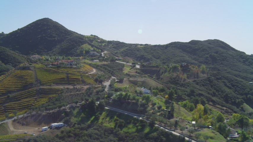 4K aerial video of flying by homes and vineyards in the hills, Malibu, California Aerial Stock Footage | DCA05_136