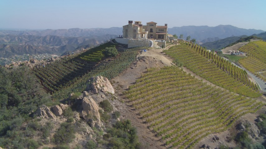 Orbiting mansion, vineyards on a hill, Malibu, California Aerial Stock Footage | DCA05_138
