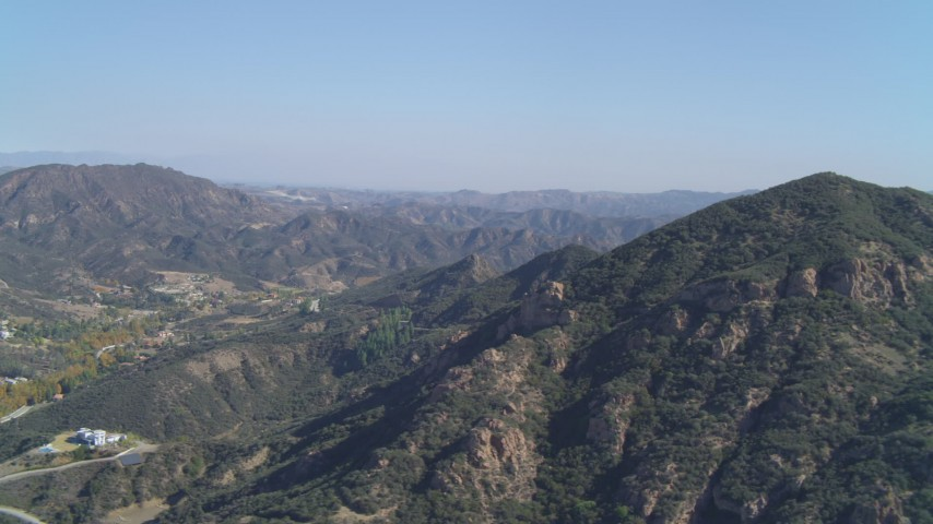 4K aerial video of flying by the Santa Monica Mountains, Malibu, California Aerial Stock Footage | DCA05_140