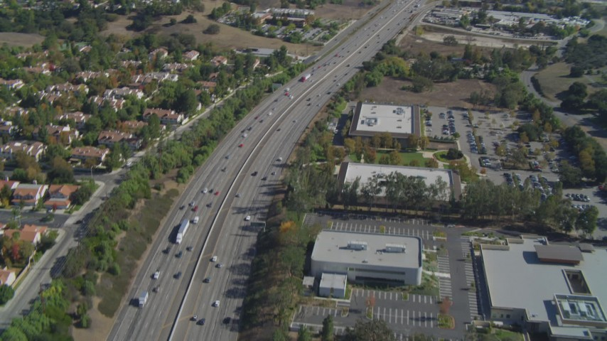 4K stock footage aerial video of flying over Highway 101, tilt up, Agoura Hills, California Aerial Stock Footage | DCA05_149