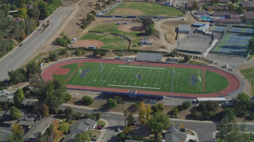 4K stock footage aerial video of flying by soccer practice, Agoura High school field, Agoura Hills, California Aerial Stock Footage | DCA05_152