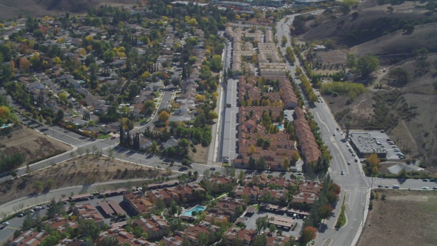 4K aerial video pan across neighborhoods, reveal apartment buildings, Calabasas, California Aerial Stock Footage | DCA05_154