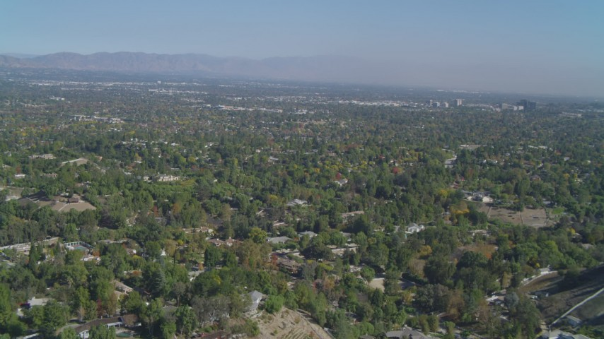 4K stock footage aerial video of flying over Hidden Hills, approaching San Fernando Valley, California Aerial Stock Footage | DCA05_156