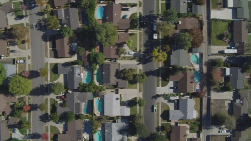 4K stock footage aerial video of a bird's eye view over neighborhoods, church, Canoga Park, California Aerial Stock Footage | DCA05_163