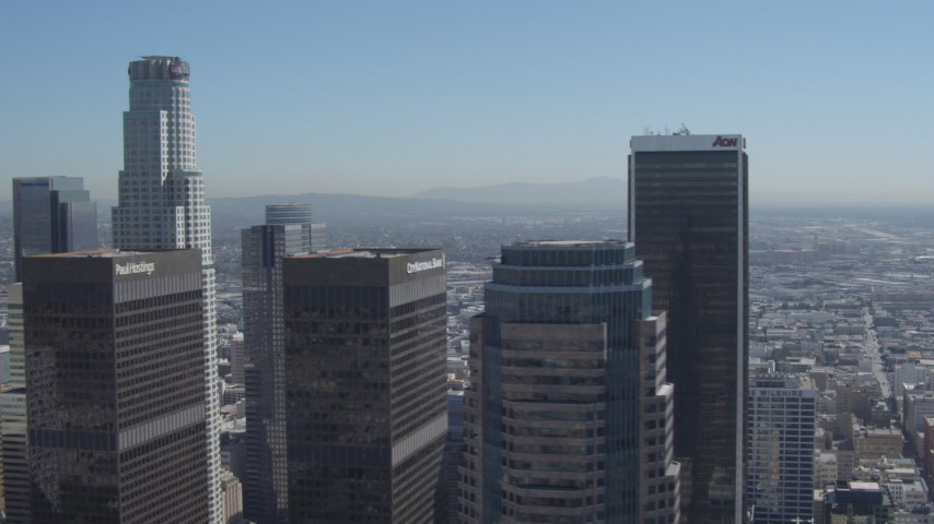 4K stock footage aerial video flyby city skyscrapers, focus on Aon Center, Downtown Los Angeles, California Aerial Stock Footage | DCA06_009