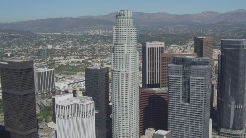 4K stock footage aerial video of flying away from US Bank Tower, reveal Aon Center, Downtown Los Angeles, California Aerial Stock Footage | DCA06_014