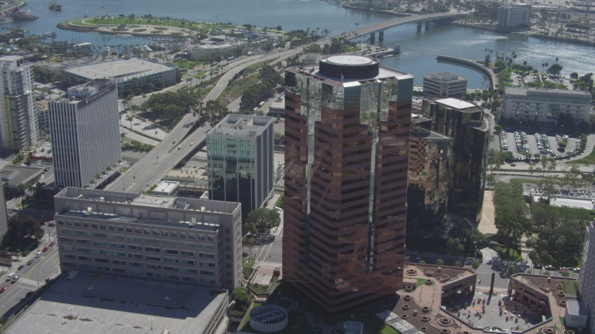 4K stock footage aerial video tilt from office building to reveal RMS Queen Mary, Downtown Long Beach, California Aerial Stock Footage | DCA06_020