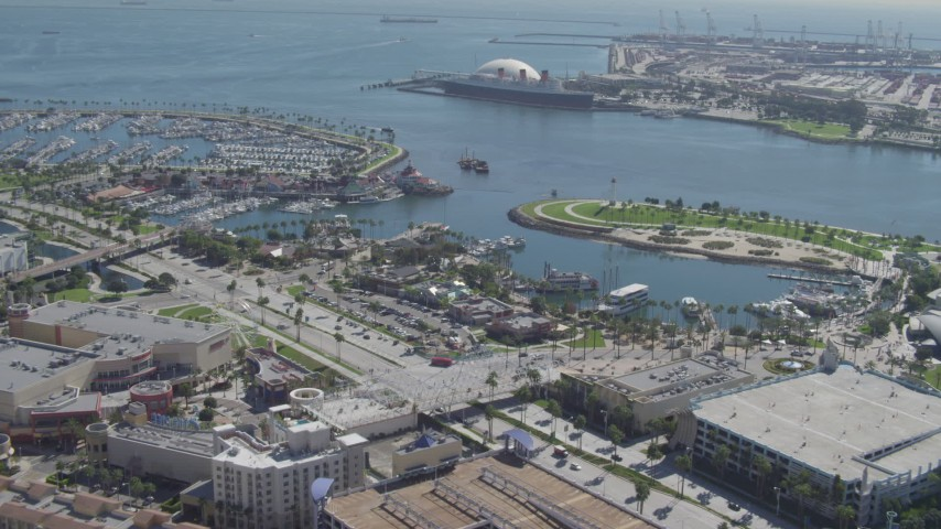 4K aerial video fly over restaurants, approaching Queen Mary, Downtown Long Beach, California Aerial Stock Footage | DCA06_021