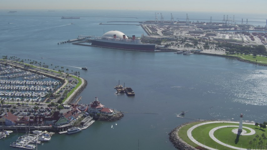 4K stock footage aerial video of approaching the Queen Mary from Downtown Long Beach, California Aerial Stock Footage | DCA06_022