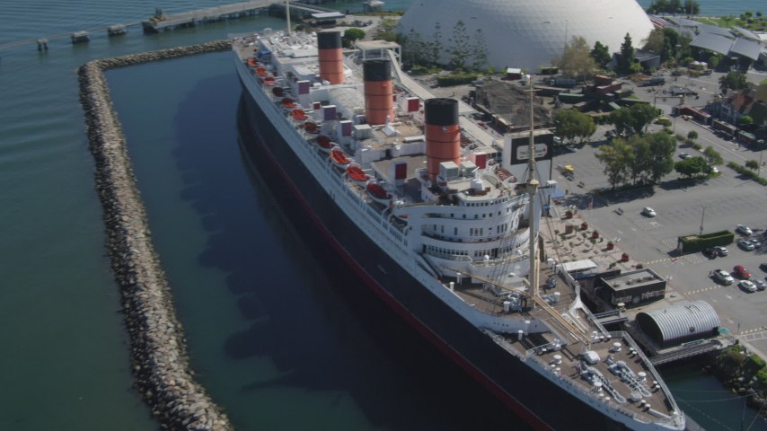 4K stock footage aerial video approach RMS Queen Mary, tilt for bird's eye of ship, Long Beach, California Aerial Stock Footage | DCA06_024