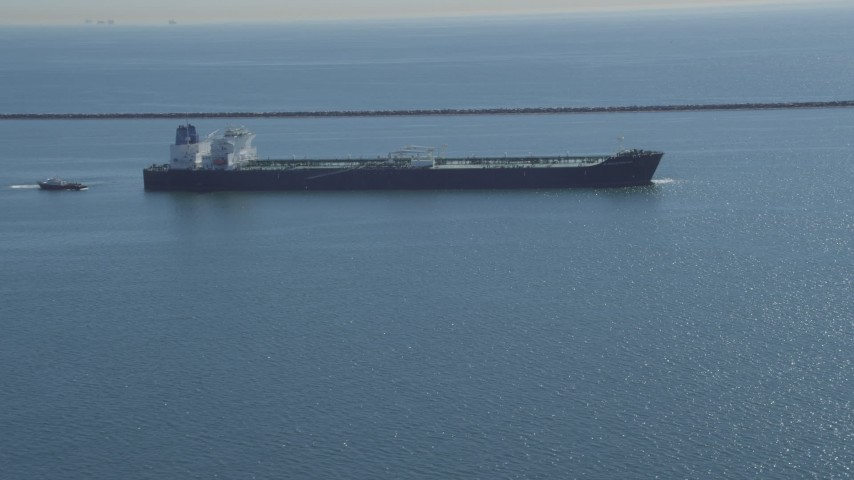 4K stock footage aerial video of flying away from oil tanker near breakwater, Long Beach, California Aerial Stock Footage | DCA06_026