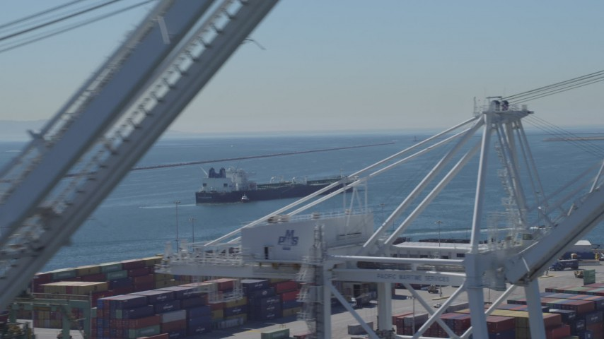 4K stock footage aerial video of an oil tanker seen from cargo cranes at Port of Long Beach, California Aerial Stock Footage | DCA06_030