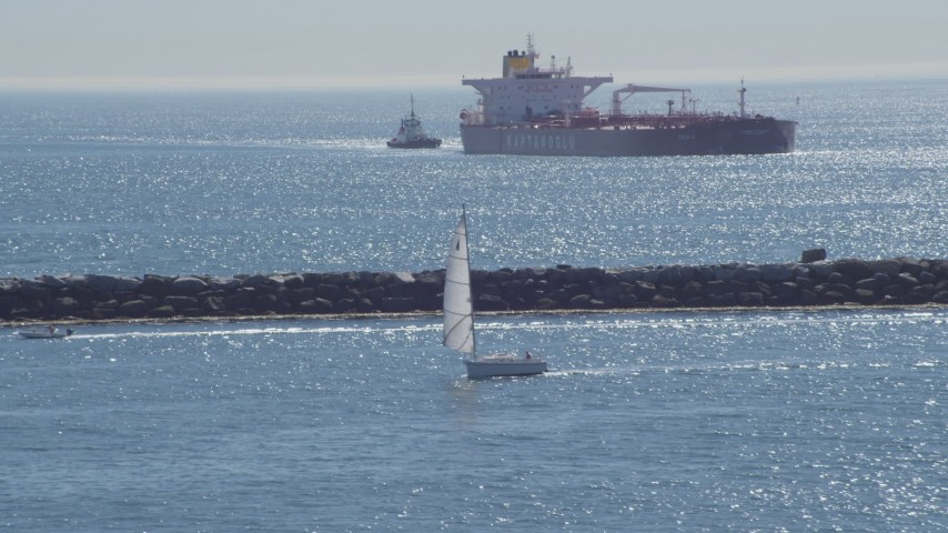 4K stock footage aerial video of a sailboat, oil tanker, and tugboat near breakwater, Long Beach, California Aerial Stock Footage | DCA06_034
