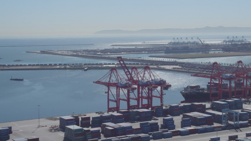 4K stock footage aerial video of flying by cargo containers, cranes, reveal cargo ship, Port of Long Beach, California Aerial Stock Footage | DCA06_041