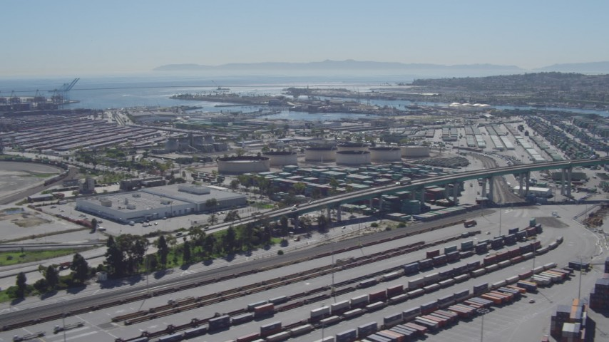 4K stock footage aerial video flyby cargo containers, reveal bridge at Port of Los Angeles, San Pedro, California Aerial Stock Footage | DCA06_043