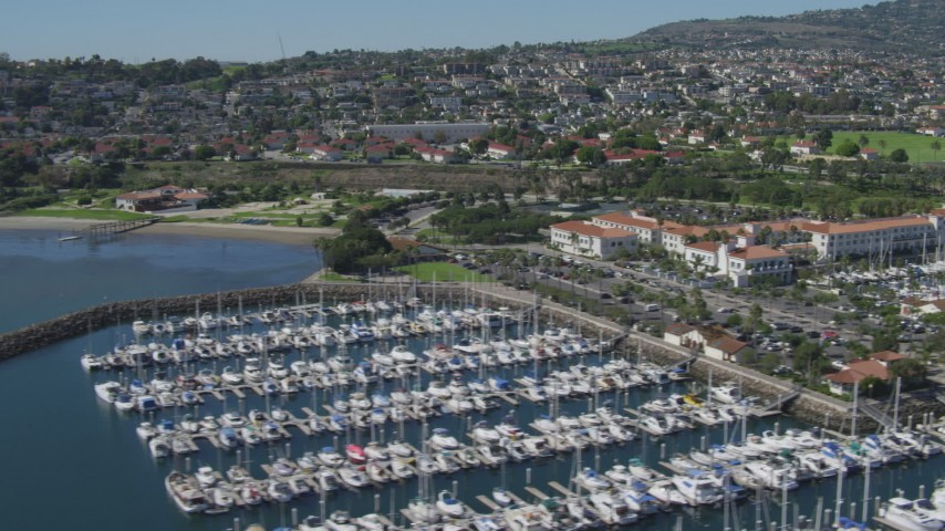 4K stock footage aerial video of flying by a hotel and a marina full of boats in San Pedro, California Aerial Stock Footage | DCA06_046
